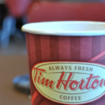 How much will new Ontario minimum wage cost Tim Hortons franchisees in 2018?